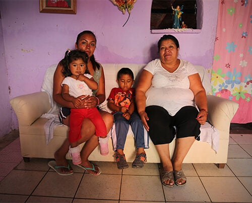 "Maria Dolores León Torres (left), at home with her family in the La Vista neighborhood of Chapala, Mexico. She and her son Juan de Dios, age 4 (center), were part of a Harvard study investigating suspected contamination in fish from Lake Chapala. ""We haven't ever gotten ill,"" she said. Photos by Ned Brown/Harvard Staff"