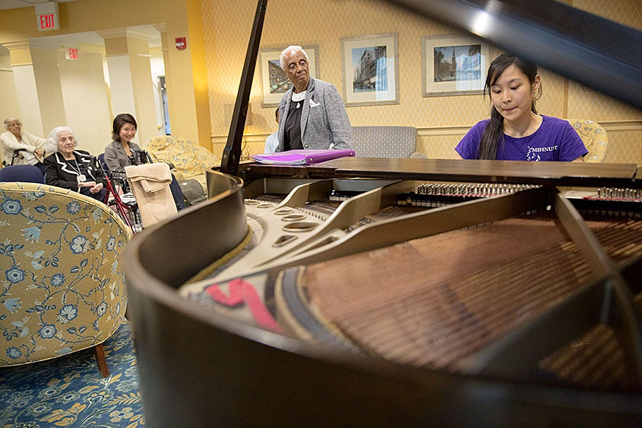 Symphony Plaza Apartments resident Marie Smith takes in the performance by Jennifer Tu '16.