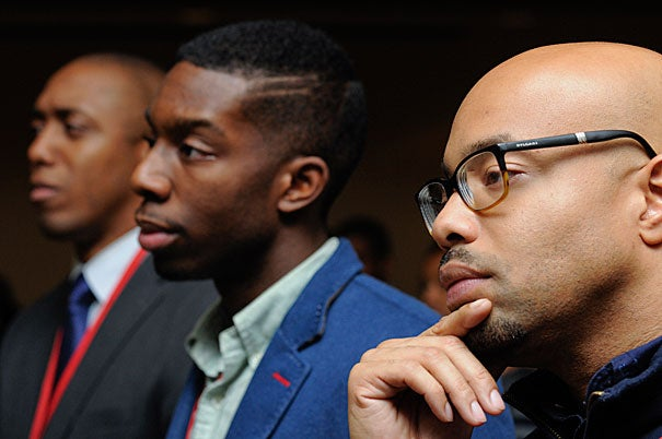 Harvard alums (photo 1) listened as President Drew Faust gave the welcoming remarks at Harvard Black Alumni Weekend on Oct. 10. Faust later posed for photos (2) at the event, which drew 700 participants. Applause and a standing ovation at the Memorial Church marked one of the many discussions during the three-day  gathering (photo 3).