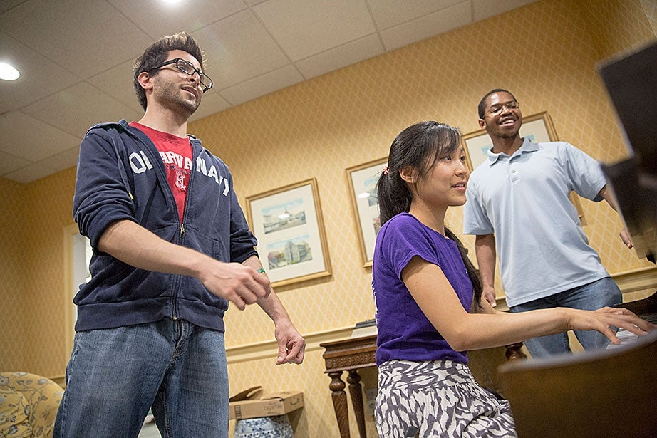 Tom Somi '14 (from left), Jennifer Tu '16, and MIHNUET co-president Kevin Sikah '15 offer a song.