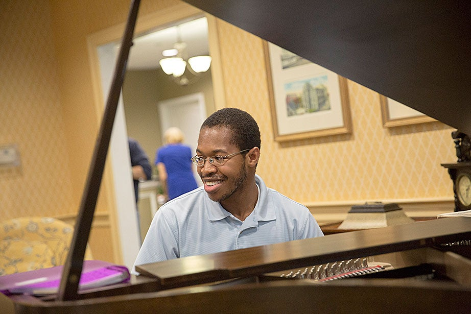 Kevin Sikah '15 takes a turn on the piano.