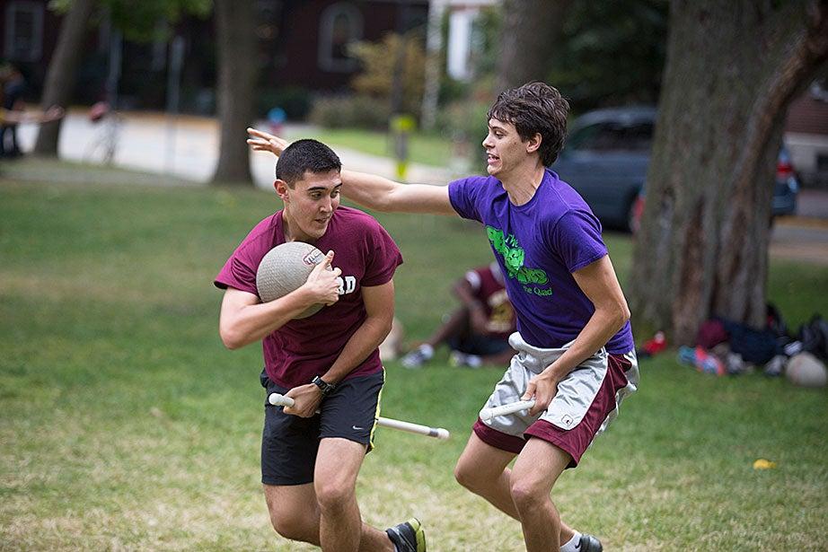Phillip Ramirez '18 (left) and Jonathan Jackson '15 ride their broomsticks.