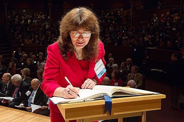 Joanna Aizenberg, the Amy Smith Berylson Professor of Materials Science, signs the American Academy of Arts and Sciences' Book of Members, a tradition that dates back to 1780.