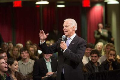 Following his prepared remarks, Vice President Joseph Biden cut loose, grabbing a handheld microphone and eagerly taking questions from students as he crisscrossed the room, town hall-style.