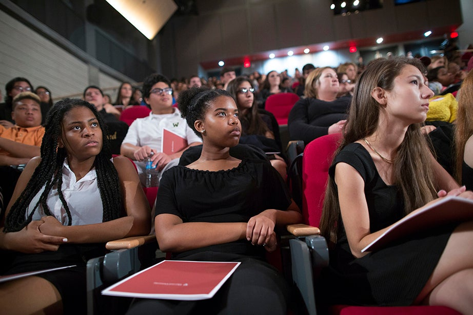 Students including Lashaun Morgan (from left), Kennedi Mayes, and Cristina Flores listen to President Drew Faust. Stephanie Mitchell/Harvard Staff Photographer