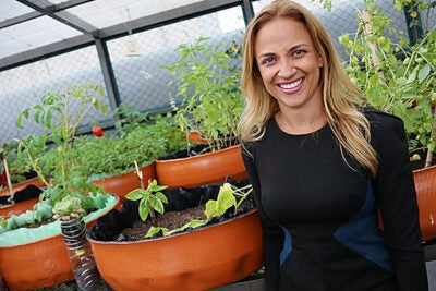 Paulina Campos, M.P.P. '07, in a rooftop garden at Infonavit, the federal institute for worker housing in Mexico. She is CEO of Fundación Hogares, a nonprofit created by Infonavit to establish community-building programs in affordable housing developments.