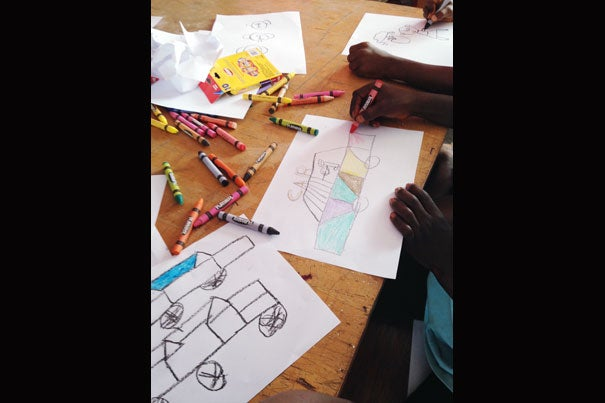Harvard Graduate School alumna Jessi Hanson traveled to Liberia after taking a monthlong leave from her job to volunteer for Playing to Live, a nonprofit focused on providing art and play therapy for quarantined children suffering the trauma of losing loved ones to the epidemic.