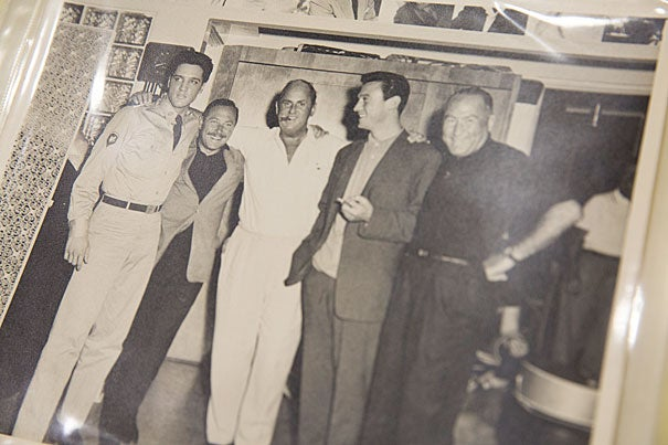 """Tennessee Williams (second from left, photo 1) poses with Elvis Presley on the set of the movie """"GI Blues"""" in 1960. The picture is part the Harvard Theatre Collection's Tennessee Williams Papers at Houghton Library. """"It's an important collection that reveals much about the playwright's life and his working process,"""" said Houghton reference librarian Micah Hoggatt (photo 2), who has helped numerous scholars search the trove of material over the past several years. Susan Pyzynski (photo 3), Houghton's associate librarian for technical services, recently discussed the Harvard Theatre Collection's Tennessee Williams Papers."""
