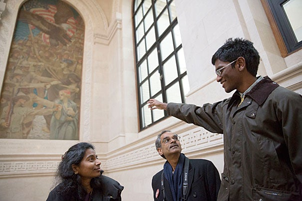 During Freshman Parents Weekend Vikram Sundar '18 and parents Shankari  (left, photo 1) and Jagane Sundar tour Widener Library, while Greg Picard '18 (left, photo 2) and his parents Suzanne and Matthew Picard from D.C., take a tour of the Yard led by Jake Levin '16 (right). Chris Ufere '18 brought his parents to the steps of Widener Library (photo 3).