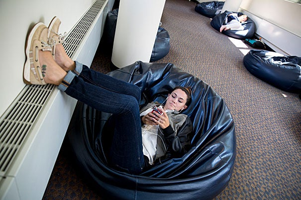 On beanbag Alley at Harvard Law School, is Kristin Bruner, an HLS staffer who works in the FRIDA department of Langdell. She comes nearly everyday to beanbag alley for her break. Rose Lincoln/Harvard Staff Photographer