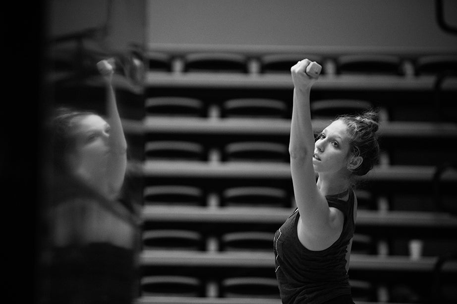 Tessa Markewich '16 lifts weights as part of strengthening exercises during class.