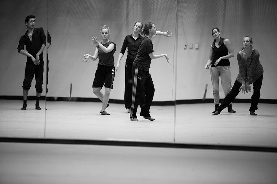 Aru Gonzalez '14, Ed.M. '15, (from left), Liza Batkin '15, Julia Cataldo '15, Jill Johnson, Whitney Cover, Ed.M. '15, and Tessa Markewich '16 are captured in the reflection of a mirror in the Dance Center's studio.