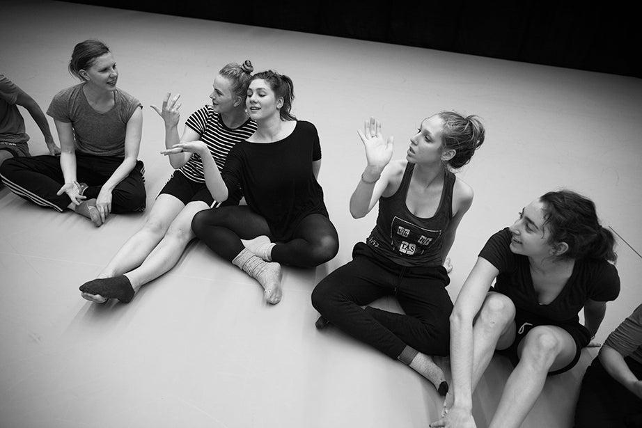 "Jill Johnson (from left), Liza Batkin '15, Maya Park '16, Tessa Markewich '16, and Lauren Balbus '17 practice a dance gesture on the floor for their most recent installation, ""Look Up."""