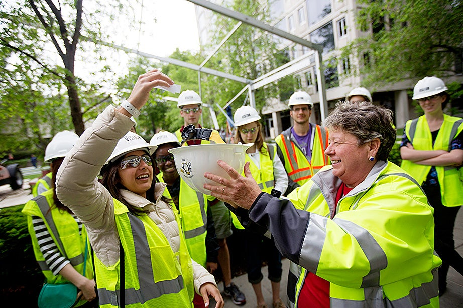 Faculty of Arts and Sciences Assistant Dean Merle Bicknell (right) led a tour of the Leverett House renewal construction site back in May. Bicknell received valuable renovation input from residents like Sarah Abushaar '14 (left). Kris Snibbe/Harvard Staff Photographer