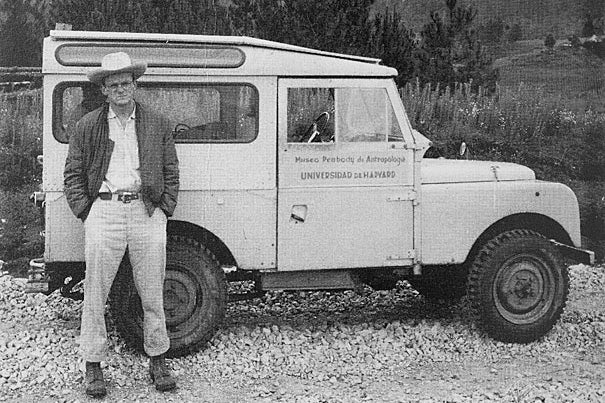 On the road in Chiapas in 1957 is Frank C. Miller, Ph.D. '60, the first graduate student to join the Harvard Chiapas Project. (photo 1). Evon Z. Vogt (photo 2), dressed for fieldwork in Zinacantan in 1965, with his wife and collaborator Nan Vogt to his right and to her right future anthropologist Victoria Reifler Bricker, Ph.D. '68.  Summer 1960: The first undergraduates to join the Harvard Chiapas Project (photo 3). Seated in front, left and right, are future anthropologists (and spouses) Jane Fishburne Collier '62 and George A. Collier '63, Ph.D. '68. Evon Vogt is second from left in the back row.
