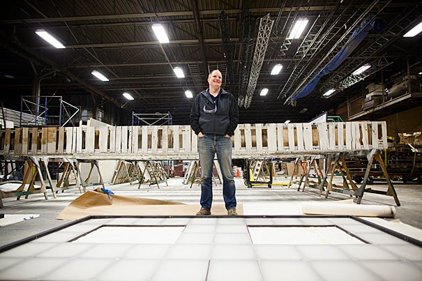 """American Repertory Theater Technical Director Stephen Setterlun helped create the set for Eve Ensler's """"O.P.C."""" out of garbage — literally — pulling materials from dumpsters, thrift shops, and even active demolitions around town."""