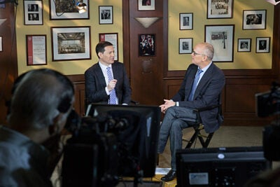 "Before veteran reporters Mark Halperin (left) and John Heilemann gave the 2014 Theodore H. White Lecture at the Harvard Kennedy School, they first broadcast their show for Bloomberg TV, ""With All Due Respect,"" from HKS's Allison Dining Room."