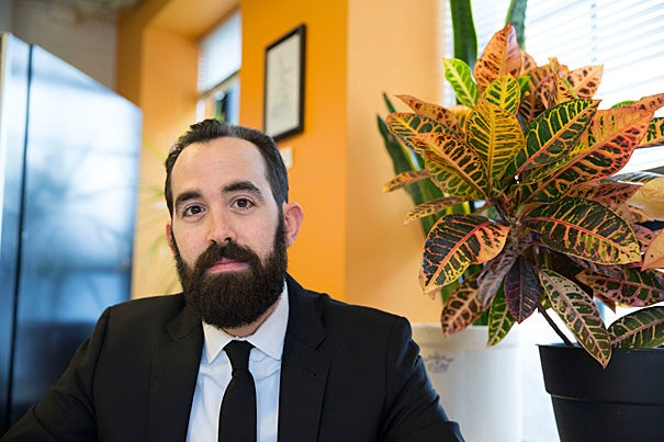 """Former Friday Night Boys bassist Rob Reider has founded a record label on the side, while keeping his day job as an administrative coordinator with Harvard's Campus Services. """"I've always had this affinity for small, DIY labels,"""" said Reider, who runs Bob Records from his Allston apartment."""