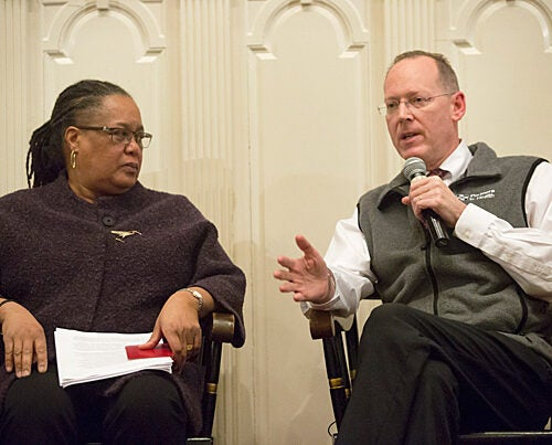 """During a Harvard-sponsored forum at First Parish in Cambridge, Professor Evelynn Hammonds (left) drew attention to the fact that epidemics """"pull the covers off"""" the ways that the poor, vulnerable, and sick are perceived. Sharing her concerns was Professor Paul Farmer: """"If we had the staff, stuff, space, and systems, we could get people earlier into a place where they could get supportive care."""" To date, most Americans stricken with Ebola have survived because they were """"scooped out"""" of miserable conditions, he noted."""