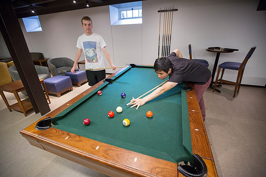 Mark Steinbach (left) and Jason Shen play pool in McKinlock Hall. Kris Snibbe/Harvard Staff Photographer