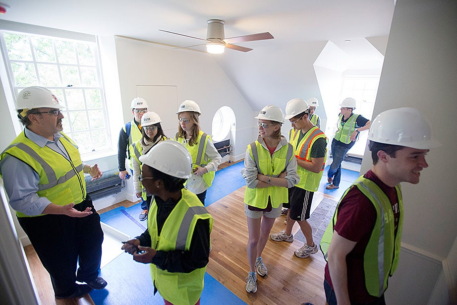 During construction inside McKinlock Hall, Steve Needham, senior director of project management, led undergraduates on a walk-through of Leverett House. Kris Snibbe/Harvard Staff Photographer