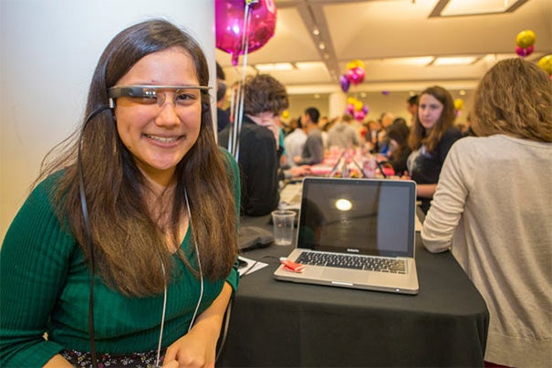 """The CS50 Fair attracted hundreds to the Northwest Labs where students displayed their projects. Emilie R. Wong '17 (photo 1), a literature student at Harvard Extension School, created a music visualization tool using Google Glass. Jacob Rienstra '17  (photo 2), who made a catalog of the portraits in Lowell House, said, """"I was always the kid at the museum who wanted to get the audio guide and listen to every entry."""" Government concentrator William Anthony Greenlaw '17 (right, photo 3),  director of Business Partnerships for Harvard's ballroom dancing team, designed a website to recruit more competitors."""