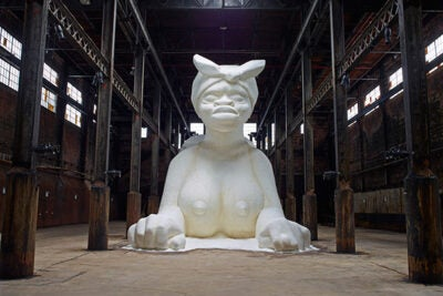"Artist Kara Walker created ""A Subtlety"" from 80 tons of granular sugar (photo 1). Walker, who spoke at Radcliffe, met with students beforehand to discuss her work (photos 2, 3). Although best known for her largely confrontational work, Walker calls herself ""a reluctant activist,"" one who spent her formative years thinking that she would follow in the footsteps of her father, the painter and art professor Larry Walker, and avoid such loaded topics in favor of more ""universal"" themes."