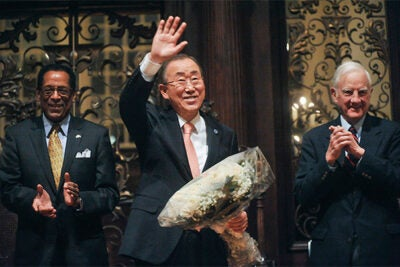 """""""The world needs you to use what you acquire here, not to perpetuate the status quo, but to be part of the transformation the world so urgently needs,"""" said United Nations Secretary-General Ban Ki-moon (center), pictured here with Harvard Foundation Director S. Allen Counter (left) and Harvard President Emeritus Derek C. Bok. Ban received the 2014 Harvard Humanitarian of the Year award."""