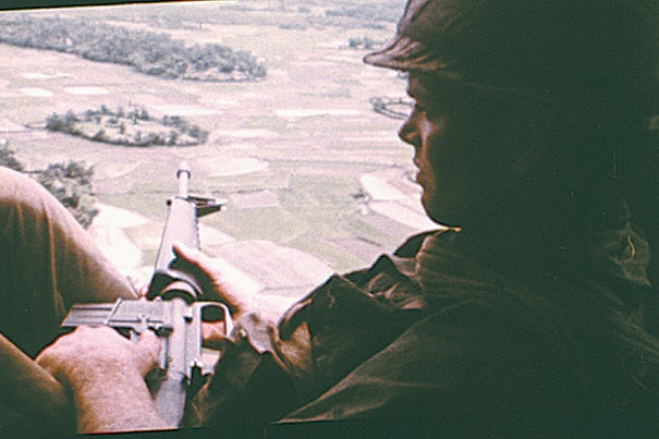 "An American soldier on helicopter patrol over South Vietnam from the film ""Hearts and Minds"" (1974)."