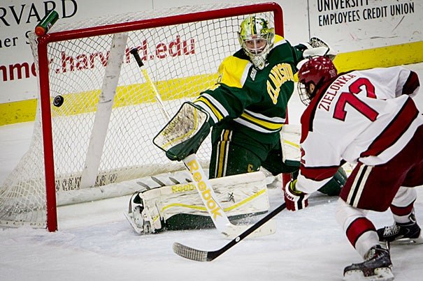 Harvard forward Phil Zielonka '17 scores the third goal on Clarkson goaltender Ville Runola during a home game at Bright-Landry Hockey Center on Jan. 16. The Crimson went on to defeat Clarkson, 6-3. On Friday, the Crimson will duel with Union, last year's national champion.