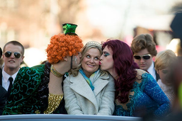 Hasty Pudding Theatricals President Jason Hellerstein '15 (left, photo 1) and Sam Clark '15, cast vice president, kept Woman of the Year Amy Poehler warm as the parade made its way through Harvard Square. A few impromptu laughs with Poehler and Clark (photo 2) gave way later in the day to the more traditional moment: presentation of the Hasty Pudding Pot (photo 3).