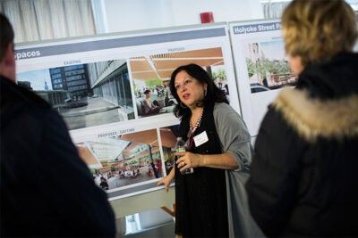 The initial design plans for the Richard A. and Susan F. Smith Campus Center were unveiled at two open houses, with at least two more scheduled for Feb. 2 and 4. Tanya Iatridis (center) was on hand to answer questions and solicit feedback on the proposed designs.