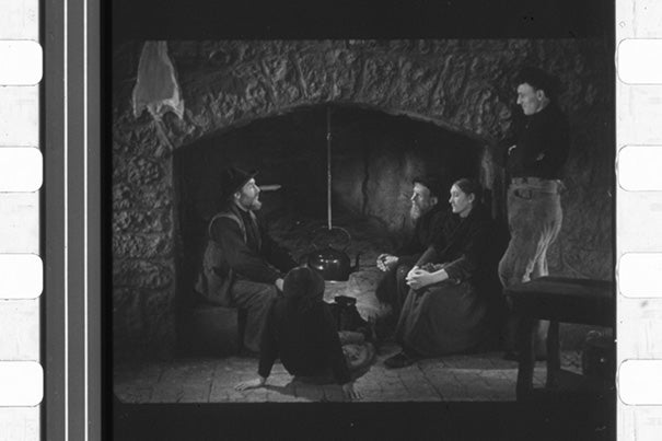 """Oidhche Sheanchais"" (""A Night of Storytelling"") by pioneer film documentarian Robert J. Flaherty used a hearthside set and featured the cast of ""Man of Aran"" (1935). The only known print of the 1935 short, the first ""talkie"" in Gaelic, was rediscovered at Houghton Library, restored, and will have its U.S. premiere during ""The Lost Worlds of Robert Flaherty,"" a Jan. 30–March 1 Harvard Film Archive series."
