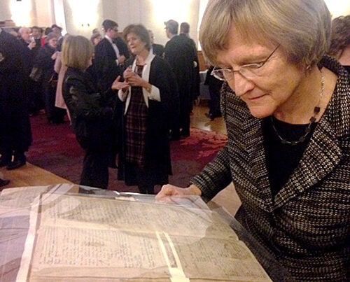 While at the University of Cambridge, Harvard President Drew Faust examined a 17th-century registration book  bearing the only known signature of a 1624 Emmanuel College matriculant named John Harvard.