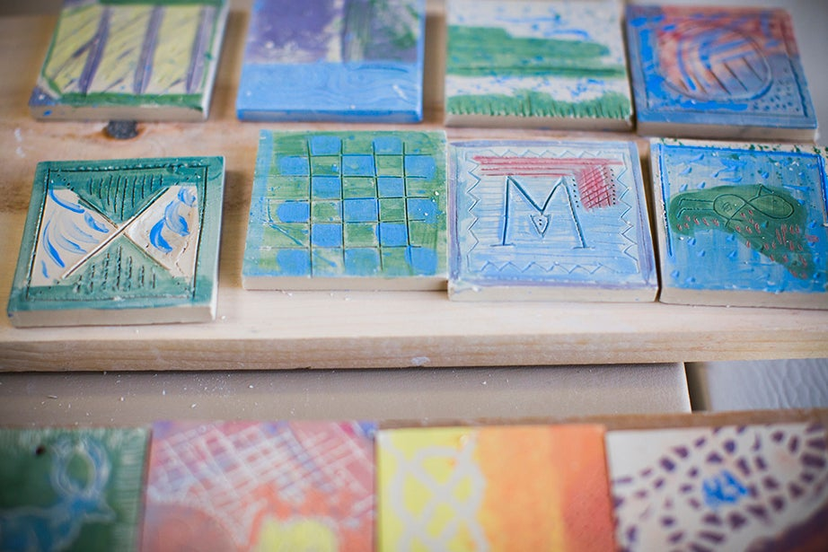 Tiles from the morning exercise are laid out to dry. Stephanie Mitchell/Harvard Staff Photographer