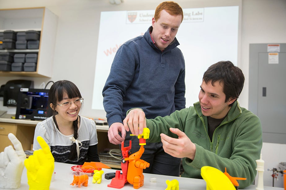 "Instructor Joe Huggard looks at 3-D printed samples during ""jFab: 3-D Printing — Fused deposition modeling"" with Rebecca Chen '16 (left) and Andrew Wong (right), an applied physics G1 student at SEAS. This hands-on instruction covered the use of Makerbot 3-D printers and 3-D scanners. Kris Snibbe/Harvard Staff Photographer"