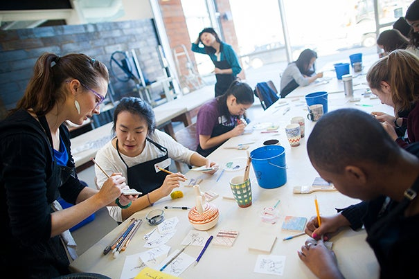 Jessica Brandl teaches Printmaking on Clay as a Wintersession class at the Harvard Ceramics Program. A variety of printmaking techniques are explored as applied to the ceramic medium as a means of personal expression. From the graphic to the painterly, techniques include traditional printmaking techniques such as mono-printing, silk screening, and stenciling onto plaster slabs to use with clay rather than the traditional paper and press. Jessica Brandl (from left) and Amy Zhao '18 are pictured during class. Stephanie Mitchell/Harvard Staff Photographer