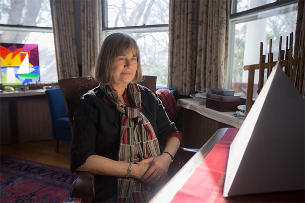 Harvard psychiatrist Jacqueline Olds offered some tips for coping with the dark days of a New England winter and the snow that accompanied it this year. While in her office, Olds demonstrated the use of a light box, a therapy often used for those who have seasonal affective disorder (SAD).