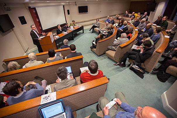 """""""Optimists think there will be an end to the Greek drama. I don't share that optimism,"""" said Dimitris Keridis (seated, left), associate professor of international relations from Panteion University in Athens. His fellow panelists, Dante Roscini, professor of management practice at HBS, and Sir Paul Tucker, senior fellow at HKS and HBS, shared the sentiment with their own testimonials on Greece's morbid state of affairs."""