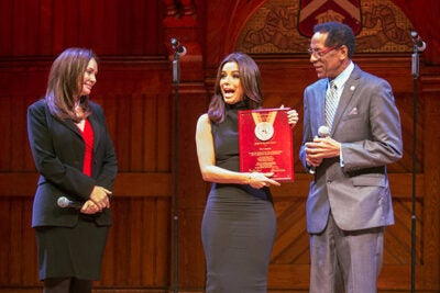 """""""I have seen the face of Harvard, and it is very diverse. And, I applaud Harvard for its diversity,"""" said Eva Longoria (center), after receiving the 2015 Harvard Foundation Artist of the Year award. Sharing the Sanders Theatre stage was U.S. Treasurer Rosie Rios '87 and Harvard Foundation Director S. Allen Counter."""