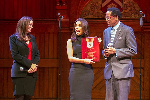 """I have seen the face of Harvard, and it is very diverse. And, I applaud Harvard for its diversity,"" said Eva Longoria (center), after receiving the 2015 Harvard Foundation Artist of the Year award. Sharing the Sanders Theatre stage was U.S. Treasurer Rosie Rios '87 and Harvard Foundation Director S. Allen Counter."
