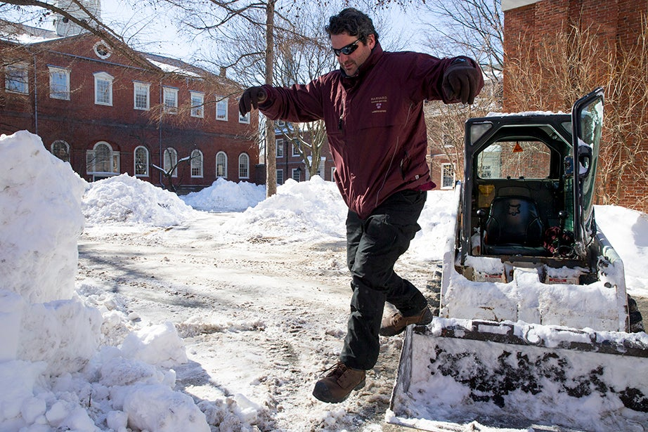 Harvard University staffer John Carroll heads to lunch after clearing snow near Holden Chapel to make room for the next blizzard, expected over the weekend. Rose Lincoln/Harvard Staff Photographer