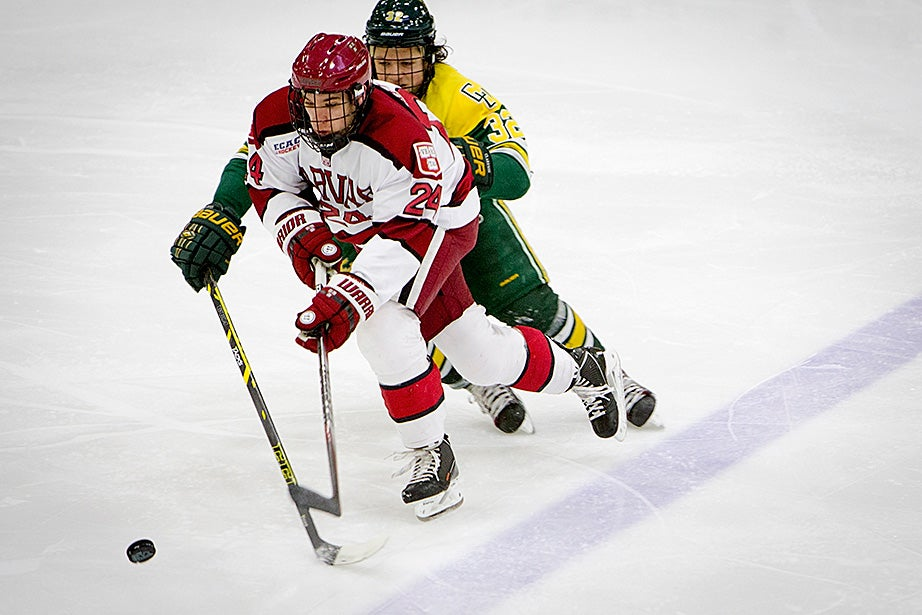 Harvard's Joey Caffrey is followed closely by Clarkson's Pat Megannety. Rose Lincoln/Harvard Staff Photographer