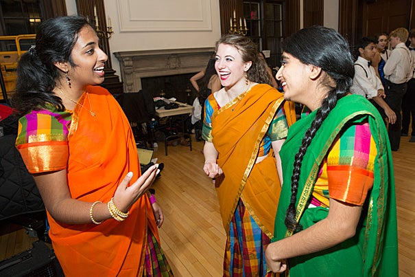 "As the largest student-run production, Ghungroo allows the students to tap their talents. Priyanka Kumar '18, (from left, photo 1), Lia Raynor '17, and Herman Kaur Bhupal '16 share a laugh after assisting each other with their outfits. Even the traditional — men in white shirts and suspenders — finds a place in the production (photo 2). Dancers practice before the show at First Church in Cambridge (photo 3). ""We're not technique-oriented,"" explained Radhika Rastogi '15, the dance director. ""We're not out to impress the audience. It's always more about energy and enthusiasm."""
