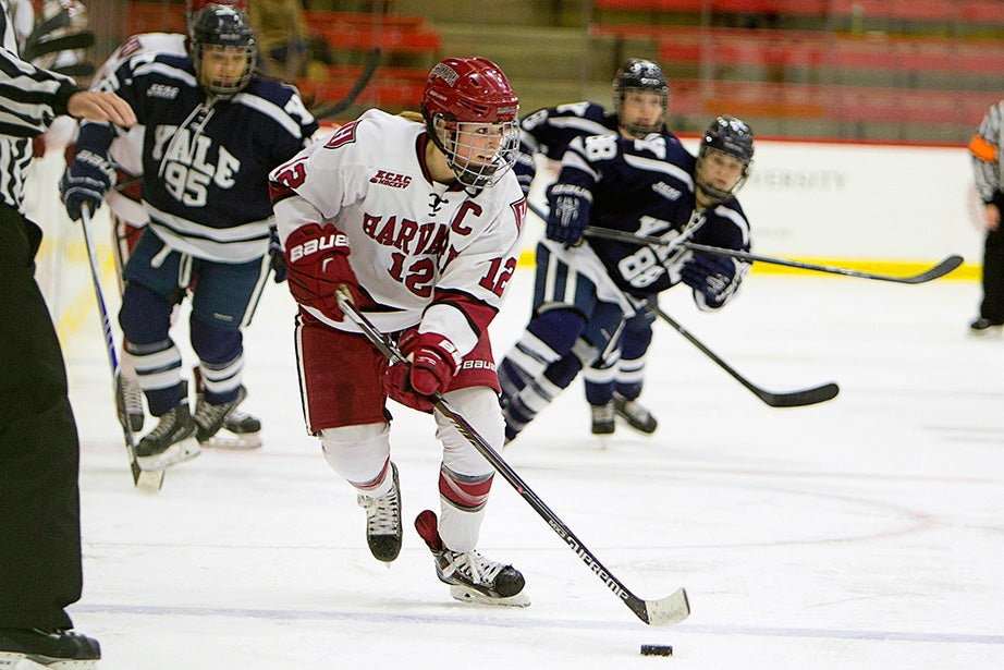 Sami Reber '15 leads a charge up ice ahead of several Yale players during the first ECAC quarterfinal game. Rose Lincoln/Harvard Staff Photographer