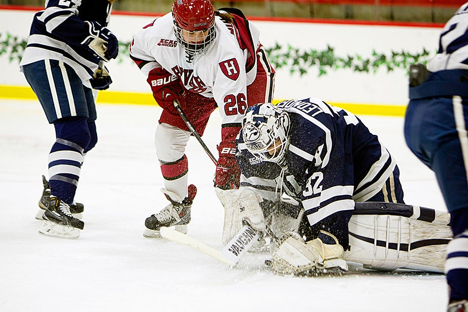 Harvard forward Haley Mullins '18 tries to poke the puck past Yale's goalie. Harvard won 2-1, and the following day beat Yale 3-0 to qualify for the semifinals. Rose Lincoln/Harvard Staff Photographer