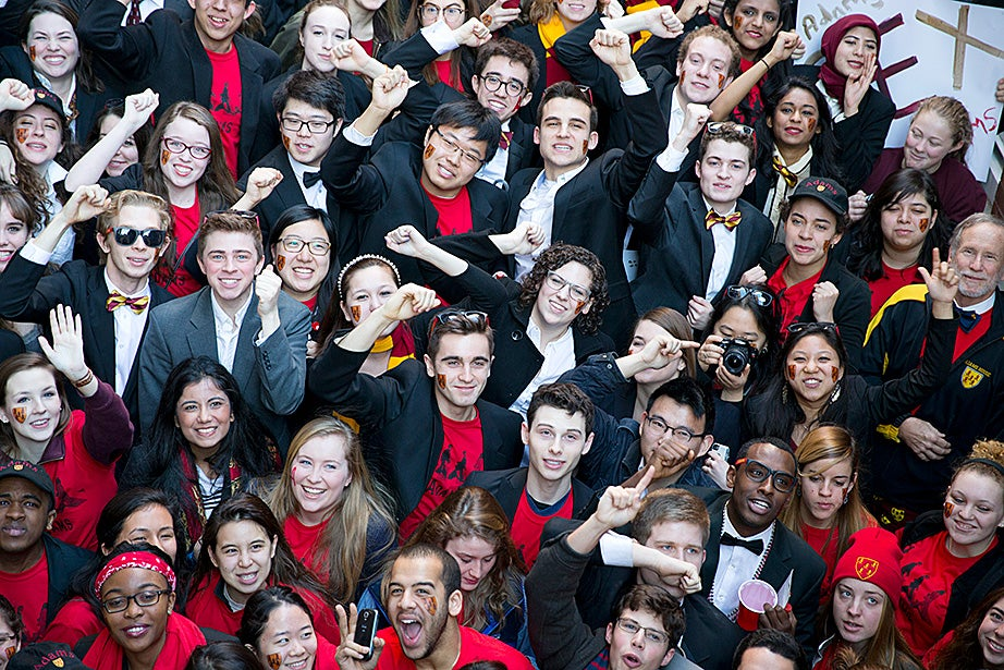 Over at Adams House, students got revved up by chanting in the stairwell before heading to the Yard. Rose Lincoln/Harvard Staff Photographer