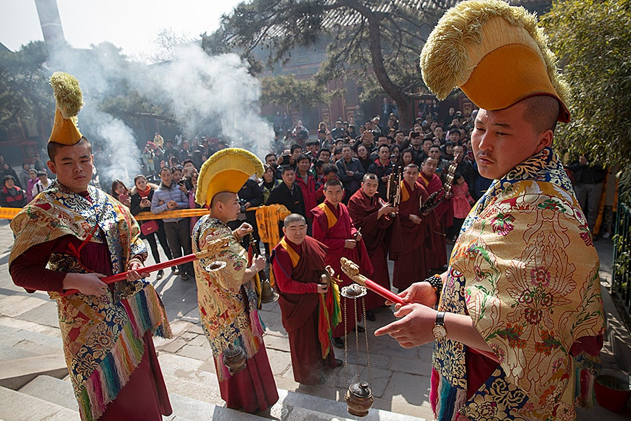 Chinese monks perform an offering ritual inside the Yonghe Temple (Palace of Peace and Harmony) in Beijing.