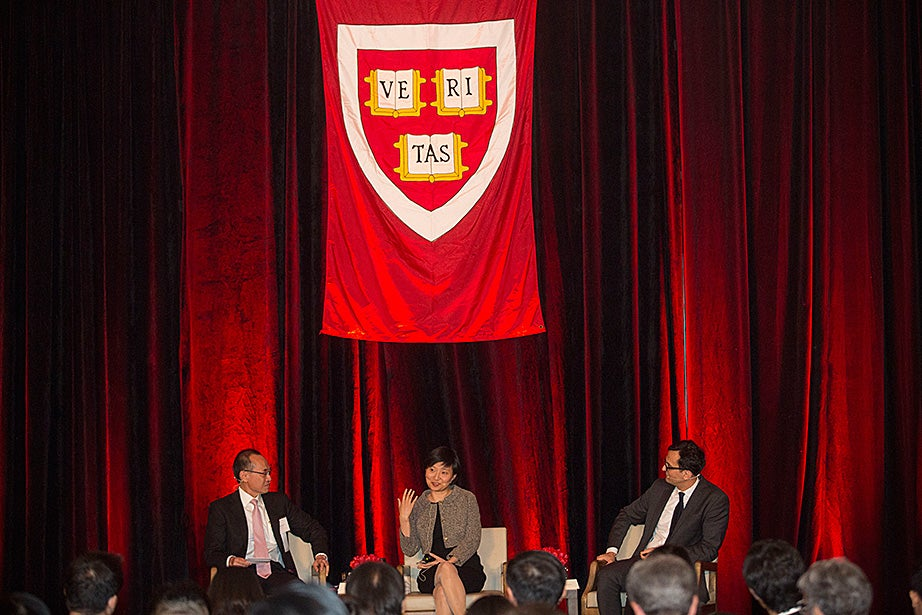 During the Your Harvard alumni event in Beijing, Kerry Logistics Chairman George Yeo, M.B.A. '85 (from left), David B. Arnold Jr. Professor of Science Xiaowei Zhuang, and Professor of Architectural Technology Ali Malkawi discuss how to visualize the invisible, from the microscopic natural world to large, human-made structures and systems like building and cities.