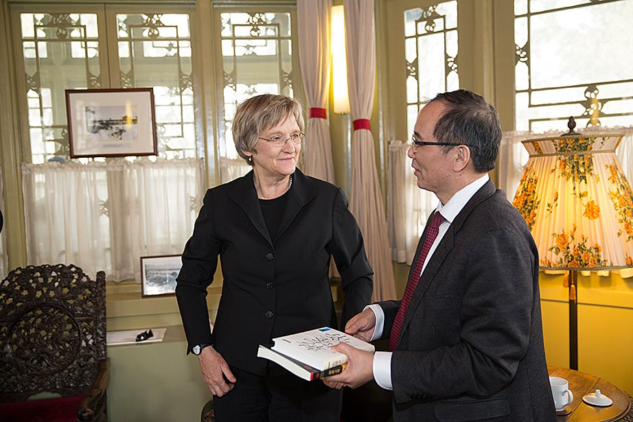 Drew Faust meets with Lin Jianhua, president of Peking University, during a visit to Peking University in Beijing.